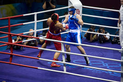 Olympic Boxer Knock out opponet. Roberto Cammarelle of Italy defeats Zhilei ZHANG of China to win the gold in the Men's Super Heavyweight boxing (+91kg/201 lbs) Stock Images