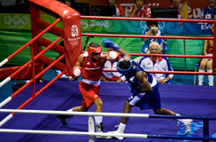 Olympic boxer throws hook punch Stock Photo
