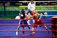 Olympic Boxing. Arroyo Acevedo McWilliams of Puerto Rico and Kalucza Norbert of Hungary trade punches in a men�s flyweight bout at the Beijing Olympics 2008 royalty free stock photo