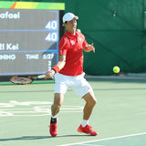 Olympic bronze medalist Kei Nishikori of Japan in action during men's singles bronze medal match of the Rio 2016 Olympic Games Royalty Free Stock Photo
