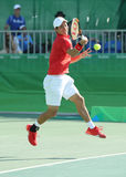 Olympic bronze medalist Kei Nishikori of Japan in action during men's singles bronze medal match of the Rio 2016 Olympic Games Royalty Free Stock Photos