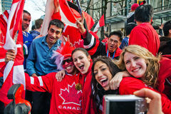Olympic Celebration. Vancouver, BC, Canada - Feb 28, 2010:  Canadians celebrate Canada Men's Hockey Team gold medal in the 2010 winter Olympic Games Royalty Free Stock Image