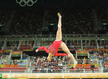 Olympic champion Aly Raisman of United States competes on the balance beam at women`s all-around gymnastics at Rio 2016 Olympics Royalty Free Stock Photos
