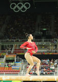 Olympic champion Aly Raisman of United States competes on the balance beam at women`s all-around gymnastics at Rio 2016 Olympics Royalty Free Stock Photo
