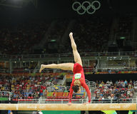 Olympic champion Aly Raisman of United States competes on the balance beam at women`s all-around gymnastics at Rio 2016 Olympics Stock Photo