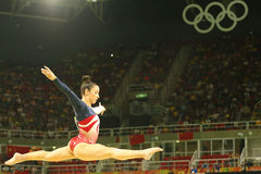 Olympic champion Aly Raisman of United States competes on the balance beam at women's team all-around gymnastics Royalty Free Stock Photography