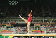 Olympic champion Aly Raisman of United States competing on the balance beam at women's all-around gymnastics at Rio 2016 Royalty Free Stock Photos