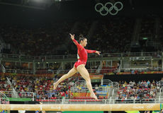 Olympic champion Aly Raisman of United States competing on the balance beam at women's all-around gymnastics at Rio 2016 Royalty Free Stock Photography