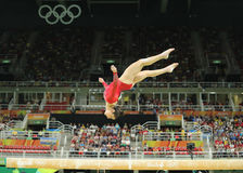 Olympic champion Aly Raisman of United States competing on the balance beam at women's all-around gymnastics at Rio 2016 Royalty Free Stock Images