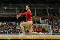 Olympic champion Aly Raisman of United States competing on the balance beam at women`s all-around gymnastics at Rio 2016 Olympics Stock Image