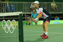 Olympic champion Andy Murray of Great Britain in action during men`s doubles first round match of the Rio 2016 Olympic Games Stock Photo