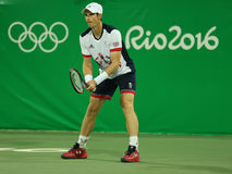 Olympic champion Andy Murray of Great Britain in action during men`s doubles first round match of the Rio 2016 Olympic Games Stock Image