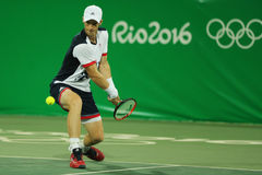 Olympic champion Andy Murray of Great Britain in action during men`s doubles first round match of the Rio 2016 Olympic Games Royalty Free Stock Photo