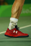 Olympic champion Andy Murray of Great Britain wears custom Under Armour tennis shoes during men`s singles final of the Rio 2016 Royalty Free Stock Photo