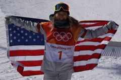 Olympic champion Chloe Kim celebrates victory in the women`s snowboard halfpipe final at the 2018 Winter Olympics Stock Image