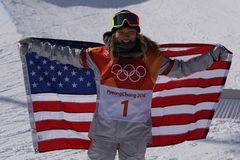Olympic champion Chloe Kim celebrates victory in the women`s snowboard halfpipe final at the 2018 Winter Olympics Stock Photo