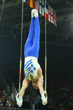 Olympic champion Eleftherios Petrounias of Greece competes at the Men`s Rings Final on artistic gymnastics competition at Rio 2016. RIO DE JANEIRO, BRAZIL Royalty Free Stock Photos