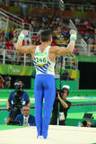 Olympic champion Eleftherios Petrounias of Greece competes at the Men`s Rings Final on artistic gymnastics competition at Rio 2016 Royalty Free Stock Photo
