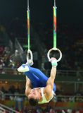Olympic champion Eleftherios Petrounias of Greece competes at the Men`s Rings Final on artistic gymnastics competition at Rio 2016 Royalty Free Stock Photos