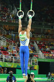 Olympic champion Eleftherios Petrounias of Greece competes at the Men`s Rings Final on artistic gymnastics competition at Rio 2016 Stock Photography