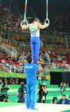 Olympic champion Eleftherios Petrounias of Greece competes at the Men`s Rings Final on artistic gymnastics competition at Rio 2016. RIO DE JANEIRO, BRAZIL Stock Photo
