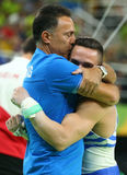 Olympic champion Eleftherios Petrounias of Greece R with his coach after Men`s Rings Final on artistic gymnastics competition Royalty Free Stock Photography