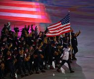 Olympic champion Erin Hamlin carrying the United States flag leading the team USA the PyeongChang 2018 Olympics opening ceremony. PYEONGCHANG, SOUTH KOREA Royalty Free Stock Photos
