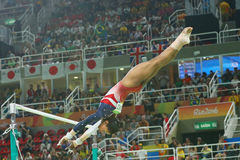 Olympic champion Gabby Douglas of United States competes on the uneven bars at women's team all-around gymnastics at Rio 2016 Stock Image