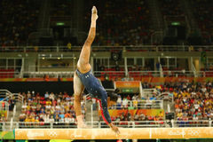 Olympic champion Gabby Douglas  of USA competes on the balance beam at women`s all-around gymnastics qualification at Rio 2016. RIO DE JANEIRO, BRAZIL AUGUST 7 Royalty Free Stock Photography
