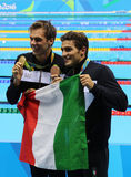 Olympic champion Gregorio Paltrinieri L and Gabriele Detti of Italy during medal presentation at the men`s 1500 metre freestyle. RIO DE JANEIRO, BRAZIL - AUGUST royalty free stock photography