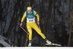 Olympic champion  Hanna Oeberg of Sweden competes in biathlon Women`s 15km Individual at the 2018 Winter Olympics. PYEONGCHANG, SOUTH KOREA - FEBRUARY 15, 2018 Stock Photos