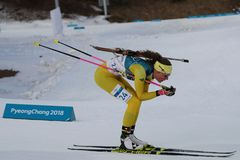Olympic champion  Hanna Oeberg of Sweden competes in biathlon Women`s 15km Individual at the 2018 Winter Olympics. PYEONGCHANG, SOUTH KOREA - FEBRUARY 15, 2018 Royalty Free Stock Image