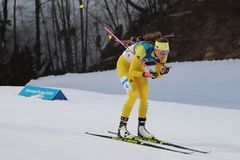 Olympic champion  Hanna Oeberg of Sweden competes in biathlon Women`s 15km Individual at the 2018 Winter Olympics. PYEONGCHANG, SOUTH KOREA - FEBRUARY 15, 2018 Royalty Free Stock Photos