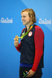 Olympic champion Katie Ledecky of USA during medal ceremony after victory at the Women's 800m freestyle of the Rio 2016 Stock Photo