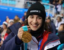 Olympic champion in Ladies` Moguls Perrine Laffont of France posing with gold medal. KWANDONG, SOUTH KOREA - FEBRUARY 14, 2018: Olympic champion in Ladies` Royalty Free Stock Photography