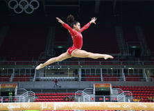Olympic champion Laurie Hernandez of United States practices on the balance beam before women`s all-around gymnastics at Rio 2016. RIO DE JANEIRO, BRAZIL Royalty Free Stock Image