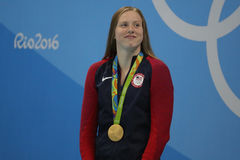 Olympic Champion Lilly King of the United States celebrates victory after Women`s 100m Breaststroke Final of the Rio 2016 Olympics Stock Photos