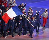 Olympic champion Martin Fourcade carrying the French flag leading the Olympic team France during the  2018 Winter Olympics opening. PYEONGCHANG, SOUTH KOREA Royalty Free Stock Photography