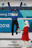 Olympic champion Martin Fourcade of France celebrates victory in biathlon men`s 15km mass start at the 2018 Winter Olympics Royalty Free Stock Images