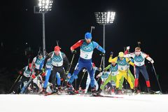 Olympic champion Martin Fourcade of France competes in the biathlon men`s 15km mass start at the 2018 Winter Olympics Royalty Free Stock Images