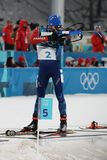 Olympic champion Martin Fourcade of France competes in the biathlon men`s 15km mass start at the 2018 Winter Olympics. PYEONGCHANG, SOUTH KOREA  FEBRUARY 18 Stock Photo
