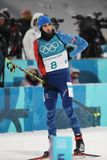 Olympic champion Martin Fourcade of France competes in biathlon men`s 12.5km pursuit at the 2018 Winter Olympics. PYEONGCHANG, SOUTH KOREA - FEBRUARY 12, 2018 Stock Photos