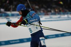 Olympic champion Martin Fourcade of France competes in biathlon men`s 12.5km pursuit at the 2018 Winter Olympics. PYEONGCHANG, SOUTH KOREA - FEBRUARY 12, 2018 Stock Images