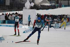 Olympic champion Martin Fourcade of France competes in biathlon men`s 12.5km pursuit at the 2018 Winter Olympics. PYEONGCHANG, SOUTH KOREA - FEBRUARY 12, 2018 Royalty Free Stock Photo