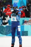 Olympic champion Martin Fourcade of France competes in biathlon men`s 12.5km pursuit at the 2018 Winter Olympics. PYEONGCHANG, SOUTH KOREA - FEBRUARY 12, 2018 Royalty Free Stock Image