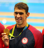 Olympic champion Michael Phelps of United States celebrates victory at the Men`s 4x100m medley relay of the Rio 2016 Royalty Free Stock Photo