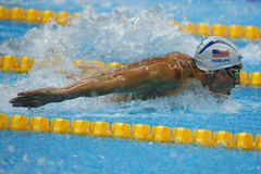 Olympic champion Michael Phelps of United States swims the Men`s 200m butterfly Heat 3 of Rio 2016 Olympic Games. RIO DE JANEIRO, BRAZIL - AUGUST 8, 2016 royalty free stock photo