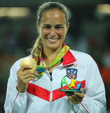 Olympic champion Monica Puig of Puerto Rico during medal ceremony after victory at tennis women`s singles final of the Rio 2016. RIO DE JANEIRO, BRAZIL - AUGUST Stock Image