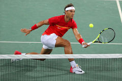 Olympic champion Rafael Nadal of Spain in action during men`s doubles round 3 of the Rio 2016 Olympic Games. RIO DE JANEIRO, BRAZIL - AUGUST 9, 2016: Olympic Royalty Free Stock Photography