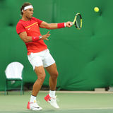 Olympic champion Rafael Nadal of Spain in action during men`s singles first round match of the Rio 2016 Olympic Games Royalty Free Stock Image